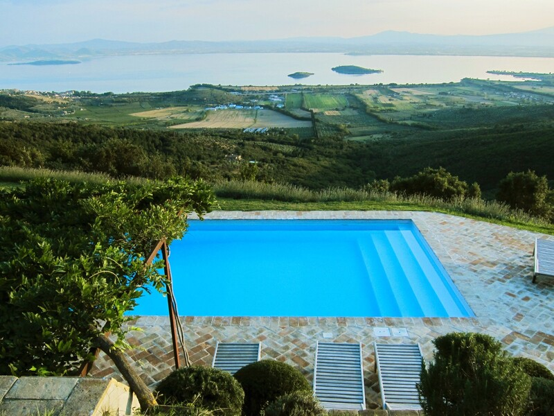 View over the pool and the Trasimeno Lake from Casa Bramasole