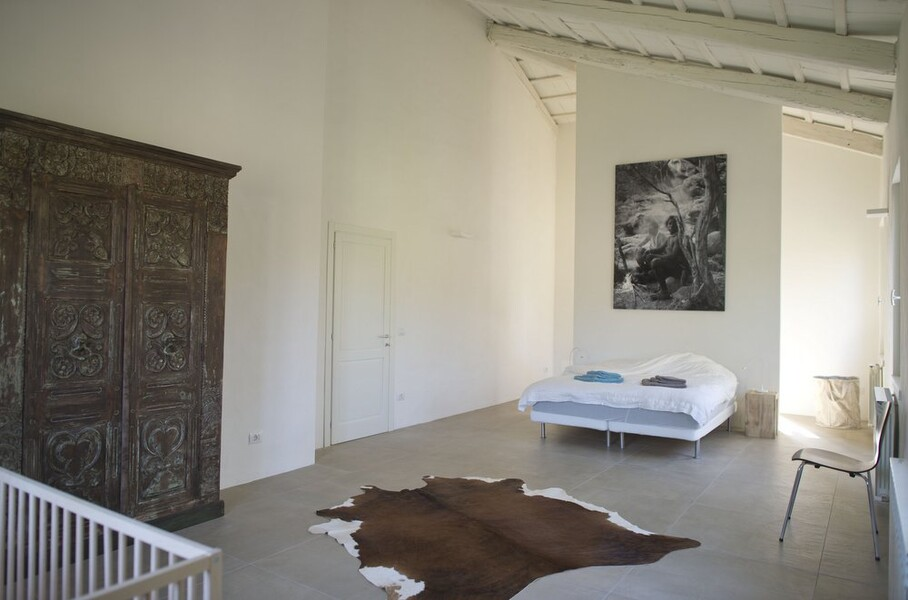 Bedroom with modern art in the holiday home Casa delle Marche